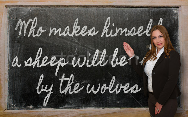 Teacher showing Who makes himself a sheep will be eaten by the w Stock photo © vepar5