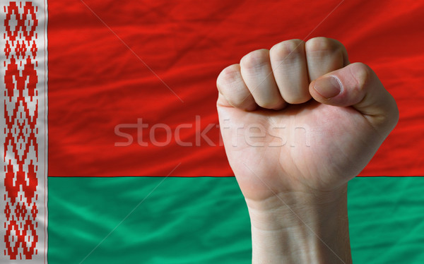 Hard fist in front of belarus flag symbolizing power Stock photo © vepar5