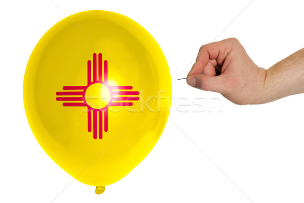 Bursting balloon colored in  flag of american state of new mexic Stock photo © vepar5