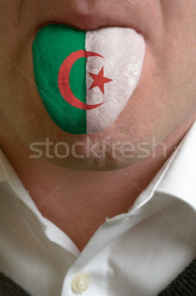 Stock photo: man tongue painted in algeria flag symbolizing to knowledge to s