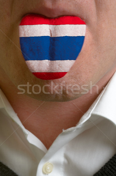 man tongue painted in thailand flag symbolizing to knowledge to  Stock photo © vepar5