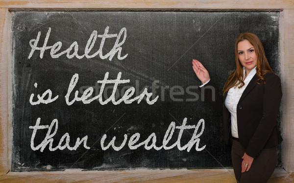 Tanár mutat egészség jobb vagyon iskolatábla Stock fotó © vepar5