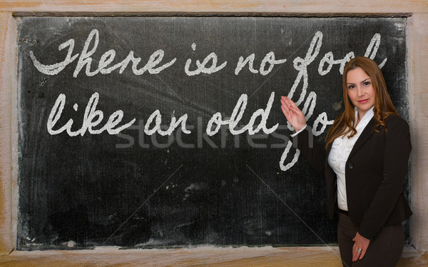 Teacher showing There is no fool like an old fool on blackboard Stock photo © vepar5