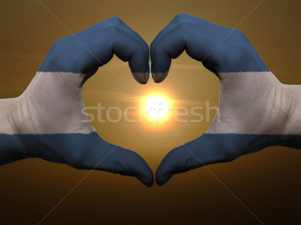 Heart and love gesture by hands colored in nicaragua flag during Stock photo © vepar5