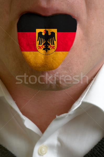Stock photo: man tongue painted in germany flag symbolizing to knowledge to s