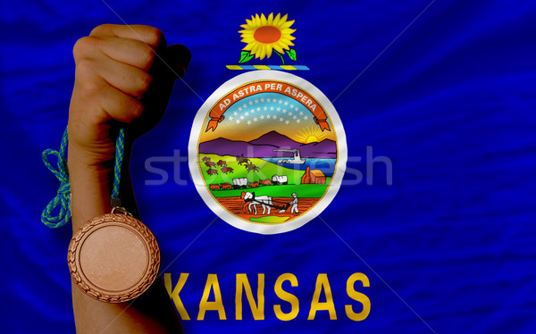 Bronze medal for sport and  flag of american state of kansas    Stock photo © vepar5
