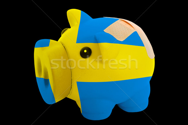 bankrupt piggy rich bank in colors of national flag of sweden    Stock photo © vepar5