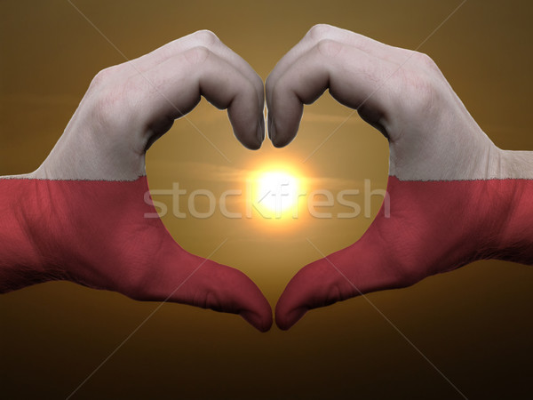 Heart and love gesture by hands colored in poland flag during be Stock photo © vepar5