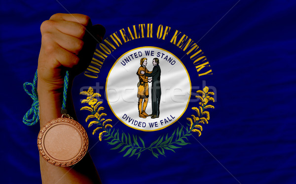 Stock photo: Bronze medal for sport and  flag of american state of kentucky