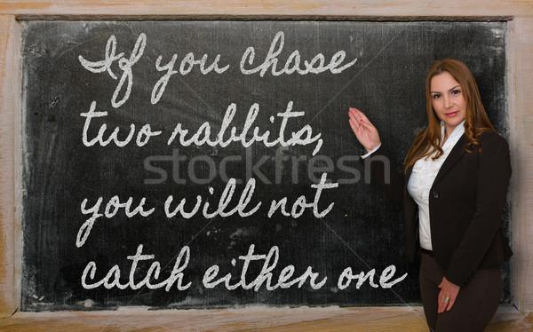 Insegnante inseguimento due conigli non Foto d'archivio © vepar5