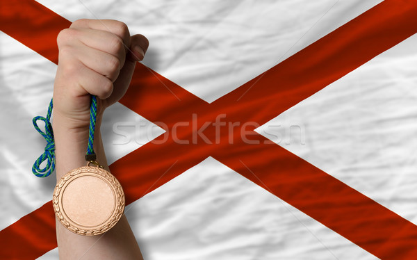 Bronze medal for sport and  flag of american state of alabama    Stock photo © vepar5