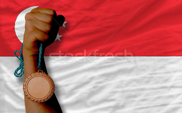 Bronze medal for sport and  national flag of singapore    Stock photo © vepar5