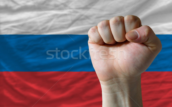 Hard fist in front of russia flag symbolizing power Stock photo © vepar5