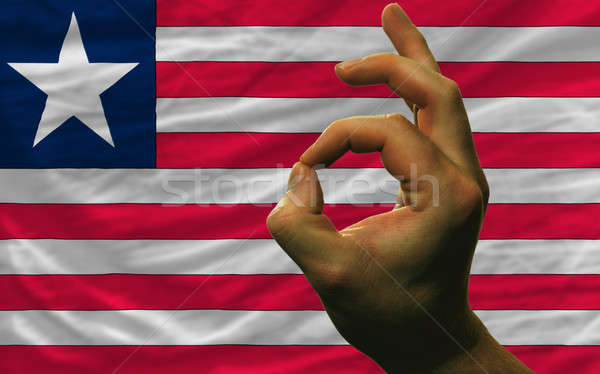 ok gesture in front of liberia national flag Stock photo © vepar5