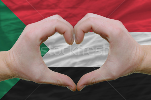 Heart and love gesture showed by hands over flag of sudan backgr Stock photo © vepar5