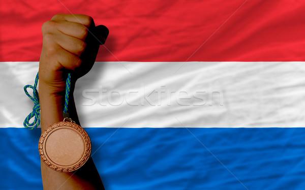 Bronz érem sport zászló Hollandia tart Stock fotó © vepar5