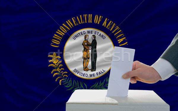 man voting on elections in front of flag US state flag of kentuc Stock photo © vepar5