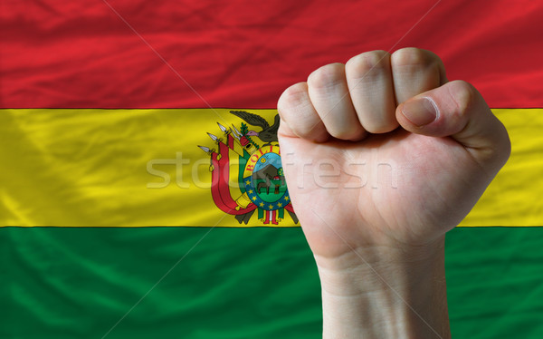 Hard fist in front of bolivia flag symbolizing power Stock photo © vepar5