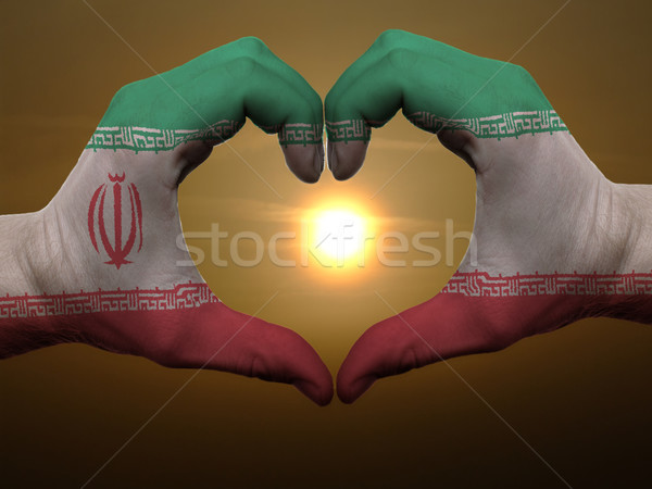 Stock photo: Heart and love gesture by hands colored in iran flag during beau