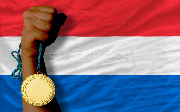 Gold medal for sport and  national flag of holland    Stock photo © vepar5