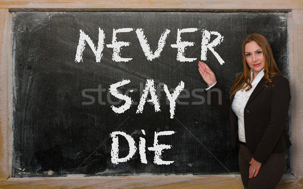 Teacher showing Never say die on blackboard Stock photo © vepar5