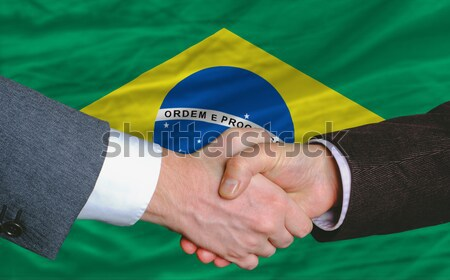 in front of american state flag of kansas two businessmen handsh Stock photo © vepar5