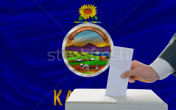 man voting on elections in front of flag US state flag of kansas Stock photo © vepar5