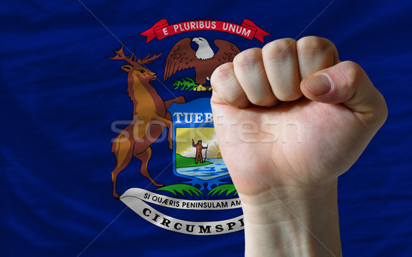 us state flag of michigan with hard fist in front of it symboliz Stock photo © vepar5