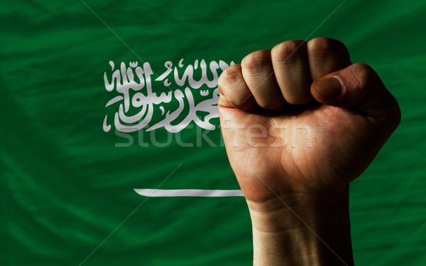 Hard fist in front of saudi arabia flag symbolizing power Stock photo © vepar5
