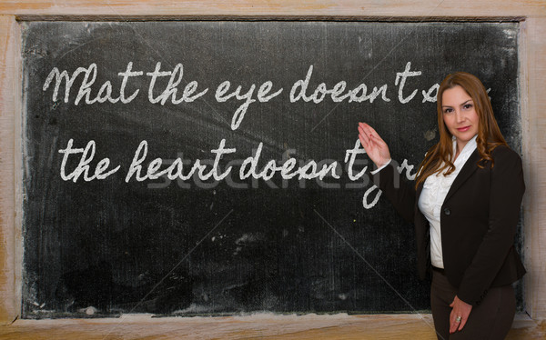 Teacher showing What the eye doesn t see, the heart doesn t grie Stock photo © vepar5