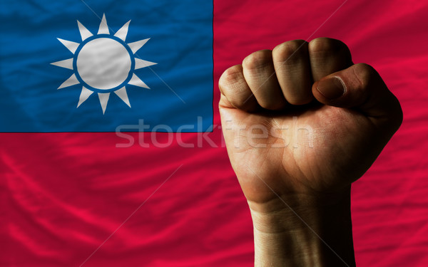 Hard fist in front of taiwan flag symbolizing power Stock photo © vepar5