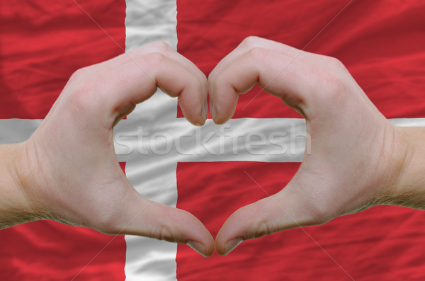 Heart and love gesture showed by hands over flag of denmark back Stock photo © vepar5