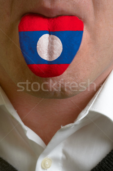 man tongue painted in laos flag symbolizing to knowledge to spea Stock photo © vepar5