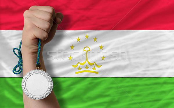 Ezüst érem sport zászló Tádzsikisztán tart Stock fotó © vepar5