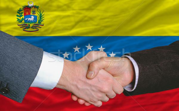 Empresários aperto de mão bom tratar Venezuela bandeira Foto stock © vepar5