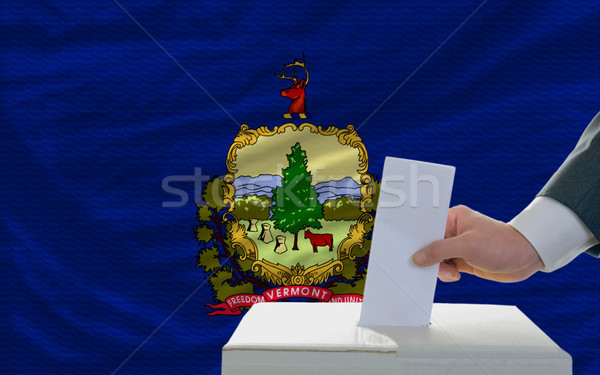 man voting on elections in front of flag US state flag of vermon Stock photo © vepar5