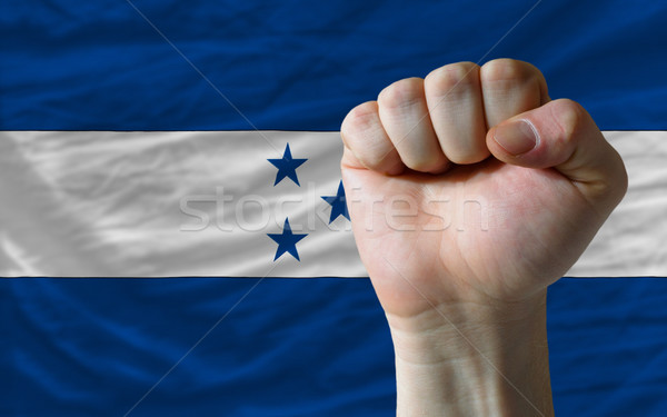 Hard fist in front of honduras flag symbolizing power Stock photo © vepar5