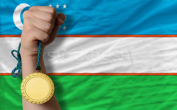 Médaille d'or sport pavillon Ouzbékistan gagnant Photo stock © vepar5