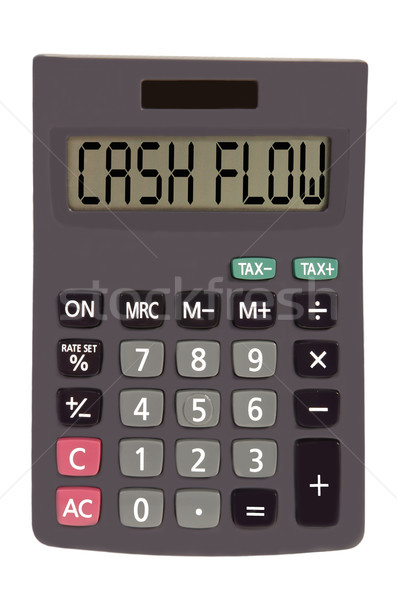Old calculator on white background showing text 'cash flow' Stock photo © vepar5