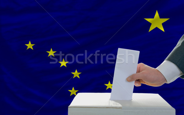 man voting on elections in front of flag US state flag of alaska Stock photo © vepar5