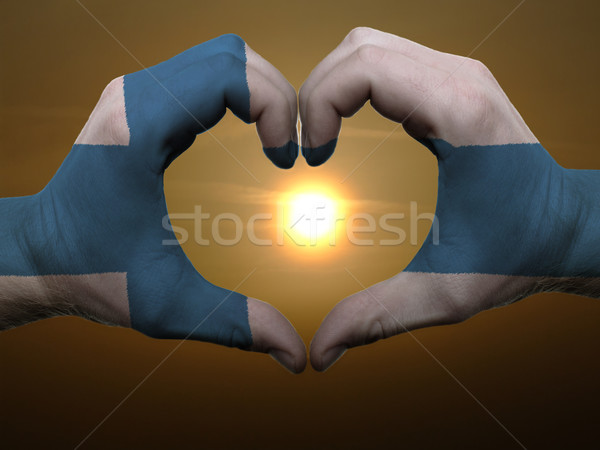 Heart and love gesture by hands colored in finland flag during b Stock photo © vepar5