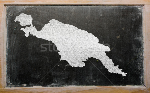 Stock photo: outline map of new guinea on blackboard