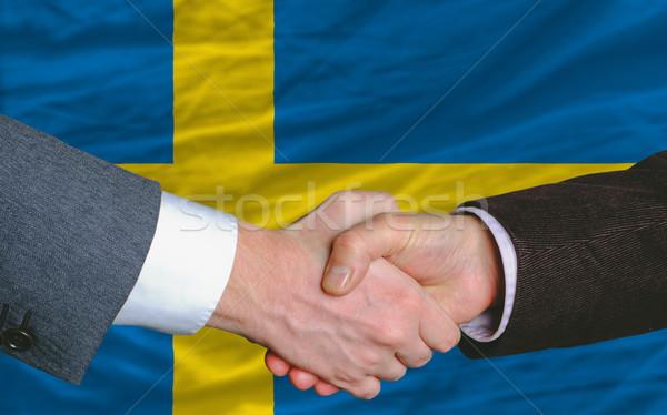 Biznesmenów handshake dobre wiele Szwecja banderą Zdjęcia stock © vepar5