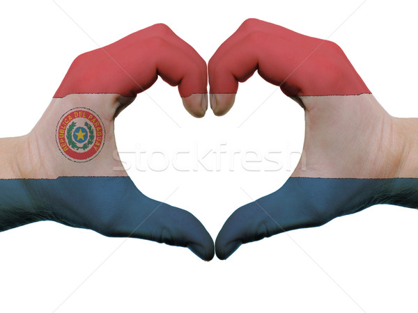 Heart and love gesture in paraguay flag colors by hands isolated Stock photo © vepar5