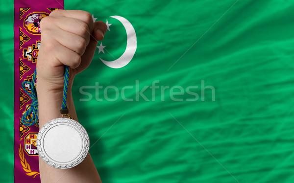 Ezüst érem sport zászló Türkmenisztán tart Stock fotó © vepar5
