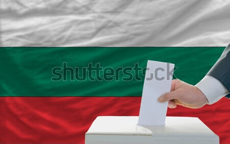 man voting on elections in front of national flag of malawi Stock photo © vepar5