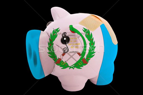 bankrupt piggy rich bank in colors of national flag of guatemala Stock photo © vepar5
