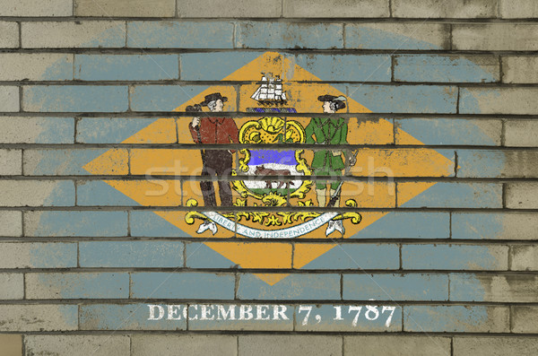 grunge flag of US state of delaware on brick wall painted with c Stock photo © vepar5