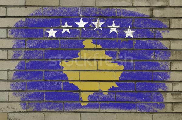Grunge bandeira Kosovo parede de tijolos pintado giz Foto stock © vepar5