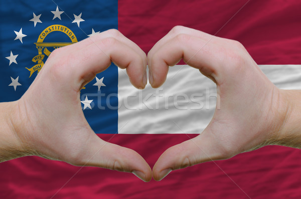 Heart and love gesture showed by hands over flag of georgia back Stock photo © vepar5